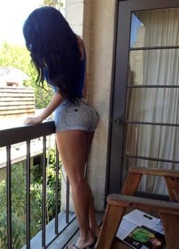 Hot latina posing with great big ass..