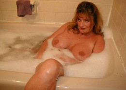 Busty lady taking a bath