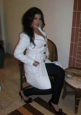 Belly dancer in white coat. Wearing..