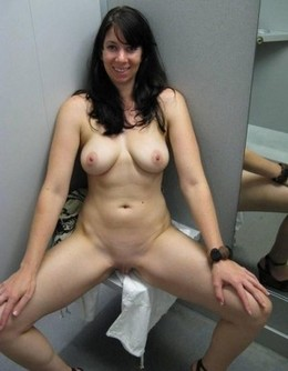 Brunette in changing room naked with..
