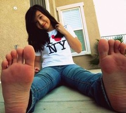an asian hot girl in jeans with sexy..