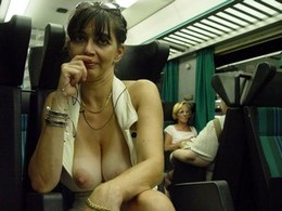 Naughty MILF on a train
