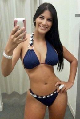 Sweet hot brunette in sexy bikini..