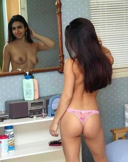 Topless cutie in front of mirror