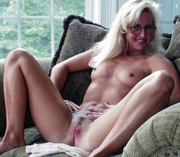 Blonde milf with small tits showing..