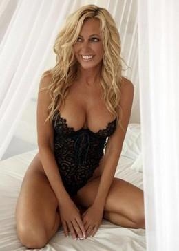Sweet blonde in hot lingerie posing..