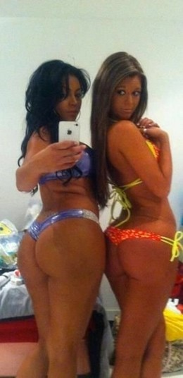 Two big booty hot latinas in bikinis..